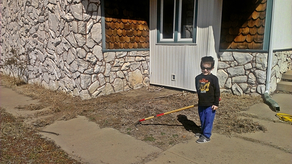 Kaden helping in the flower bed