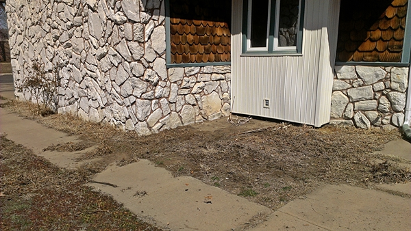Rock bed flower bed makeover - Before