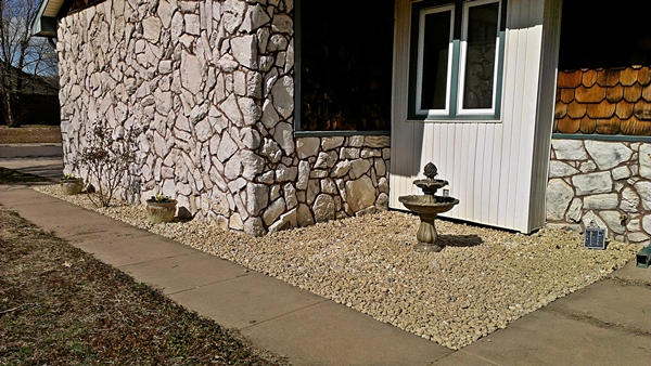 rock bed flower bed makeover - after